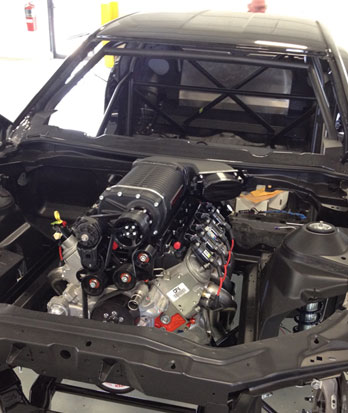 A COPO Camaro's drivetrain is installed